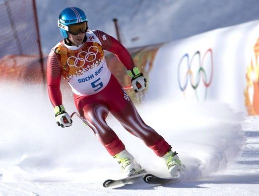 Feb 7, 2014; Krasnaya Polyana, RUSSIA; Beat Feuz (SUI) during men's alpine training for the Sochi 2014 Olympic Winter Games at Rosa Khutor Alpine Center. Mandatory Credit: Andrew P. Scott-USA TODAY Sports