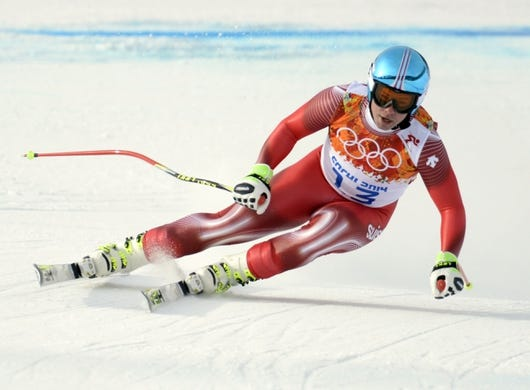 Feb 9, 2014; Krasnaya Polyana, RUSSIA;  Beat Feuz (SUI) competes in the men's downhill during the Sochi 2014 Olympic Winter Games at Rosa Khutor Alpine Center. Mandatory Credit: Eric Bolte-USA TODAY Sports