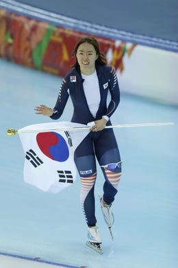 Feb 11, 2014; Sochi, RUSSIA; Sang Hwa Lee (KOR) celebrates winning the gold medal in the ladies speed skating 500m at Adler Arena Skating Center during the Sochi 2014 Olympic Winter Games. Mandatory Credit: Jeff Swinger-USA TODAY Sports