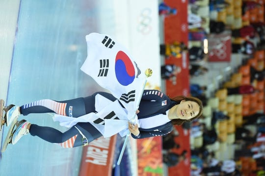 Feb 11, 2014; Sochi, RUSSIA; Sang Hwa Lee (KOR) celebrates winning the gold medal in the ladies speed skating 500m at Adler Arena Skating Center during Sochi 2014 Olympic Winter Games. Mandatory Credit: Robert Hanashiro-USA TODAY Sports