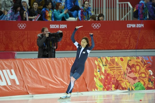 Feb 11, 2014; Sochi, RUSSIA; Sang Hwa Lee (KOR) celebrates after winning the gold medal in the ladies speed skating 500m at Adler Arena Skating Center during Sochi 2014 Olympic Winter Games. Mandatory Credit: Robert Hanashiro-USA TODAY Sports