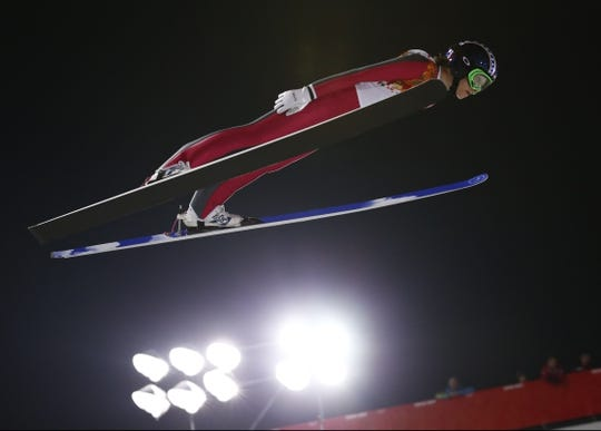 Feb 11, 2014; Krasnaya Polyana, RUSSIA; Sarah Hendrickson (USA) takes a trial jump before the first round during the Sochi 2014 Olympic Winter Games at RusSki Gorki Ski Jumping Center. Mandatory Credit: Rob Schumacher-USA TODAY Sports