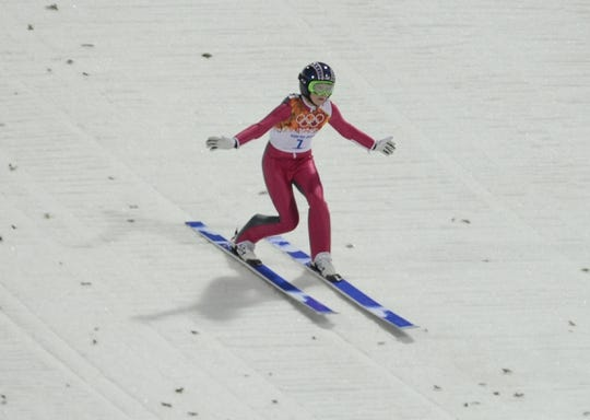 Feb 11, 2014; Krasnaya Polyana, RUSSIA; Sarah Hendrickson (USA) lands the first jump of the first round during the Sochi 2014 Olympic Winter Games at RusSki Gorki Ski Jumping Center.  Mandatory Credit: Jack Gruber-USA TODAY Sports
