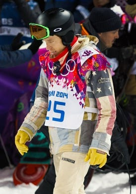 Feb 11, 2014; Krasnaya Polyana, RUSSIA; Shaun White (USA) walks away after fail to medal in the men's snowboarding halfpipe finals of the Sochi 2014 Olympic Winter Games at Rosa Khutor Extreme Park. Mandatory Credit: Guy Rhodes-USA TODAY Sports