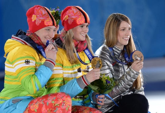Feb 12, 2014; Sochi, RUSSIA; Natalie Geisenberger (GER), middle, Tatjana Heufner (GER), left, and Erin Hamlin (USA), right, pose with their medals during the medal ceremony for the women's singles luge during the Sochi 2014 Olympic Winter Games at the Medals Plaza. Mandatory Credit: James Lang-USA TODAY Sports