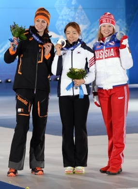 Feb 12, 2014; Sochi, RUSSIA; Margot Boer (NED), left, Sang Hwa Lee (KOR), middle, and Olga Fatkulina (RUS) pose with their medals during the medal ceremony for the ladies' speedskating 500m during the Sochi 2014 Olympic Winter Games at the Medals Plaza. Mandatory Credit: James Lang-USA TODAY Sports