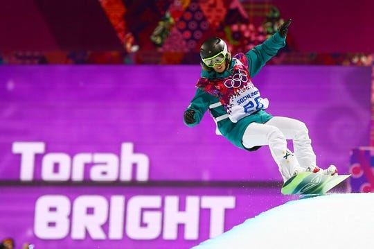 Feb 12, 2014; Krasnaya Polyana, RUSSIA; Torah Bright (AUS) on her second finals run in the ladies snowboard halfpipe during the Sochi 2014 Olympic Winter Games at Rosa Khutor Extreme Park. Mandatory Credit: Guy Rhodes-USA TODAY Sports