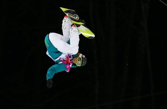 Feb 12, 2014; Krasnaya Polyana, RUSSIA; Torah Bright (AUS) on her first finals run in the ladies snowboard halfpipe during the Sochi 2014 Olympic Winter Games at Rosa Khutor Extreme Park. Mandatory Credit: Guy Rhodes-USA TODAY Sports