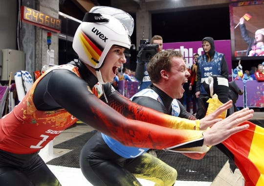 Feb 13, 2014; Krasnaya Polyana, RUSSIA; Natalie Geisenberger (left) and Felix Loch (right) (GER) react after their portion of the luge team relay during the Sochi 2014 Olympic Winter Games at Sanki Sliding Center. Mandatory Credit: Kevin Jairaj-USA TODAY Sports