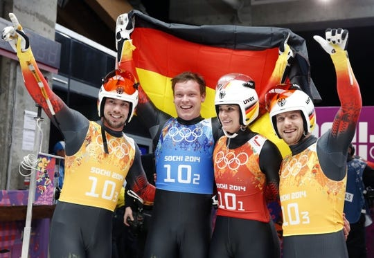 Feb 13, 2014; Krasnaya Polyana, RUSSIA; (From left to right) Tobias Wendl, Felix Loch, Natalie Geisenberger, and Tobias Arlt (GER) react after their run in the luge team relay during the Sochi 2014 Olympic Winter Games at Sanki Sliding Center. Mandatory Credit: Kevin Jairaj-USA TODAY Sports