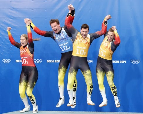 Feb 13, 2014; Krasnaya Polyana, RUSSIA; (From left to right) Natalie Geisenberger, Felix Loch, Tobias Wendl, and Tobias Arlt celebrate with after winning gold in the luge team relay during the Sochi 2014 Olympic Winter Games at Sanki Sliding Center. Mandatory Credit: Kevin Jairaj-USA TODAY Sports