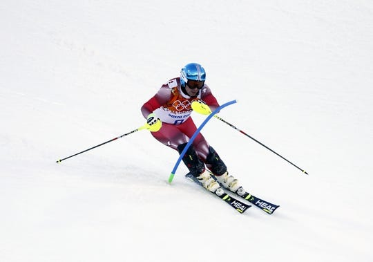 Feb 14, 2014; Krasnaya Polyana, RUSSIA; Beat Feuz (SUI) competes in men's super combined slalom during the Sochi 2014 Olympic Winter Games at Rosa Khutor Alpine Center. Mandatory Credit: Rob Schumacher-USA TODAY Sports