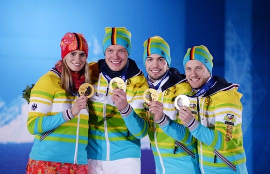 Feb 14, 2014; Sochi, RUSSIA; (Left to right) Natalie Geisenberger, Felix Loch, Tobias Wendl, Tobias Arlt of Germany wave to the crowd after receiving their gold medals during the medal ceremony for Luge Team Relay at the Sochi 2014 Olympic Winter Games at the Medals Plaza. Mandatory Credit: Kyle Terada-USA TODAY Sports