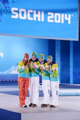 Feb 14, 2014; Sochi, RUSSIA; (Left to right) Natalie Geisenberger, Felix Loch, Tobias Wendl, Tobias Arlt of Germany pose for photos after receiving their gold medals during the medal ceremony for Luge Team Relay at the Sochi 2014 Olympic Winter Games at the Medals Plaza. Mandatory Credit: Kyle Terada-USA TODAY Sports