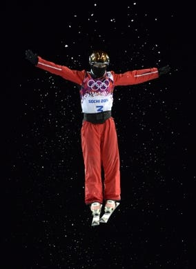 Feb 14, 2014; Krasnaya Polyana, RUSSIA; Mengtao Xu (CHN) competes in the ladies' freestyle skiing aerials finals during the Sochi 2014 Olympic Winter Games at Rosa Khutor Extreme Park. Mandatory Credit: Jack Gruber-USA TODAY Sports