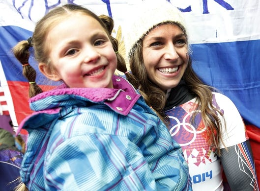 Feb 14, 2014; Krasnaya Polyana, RUSSIA; Noelle Pikus-Pace (USA) celebrates with daughter Lacee following her silver medal win in the ladies skeleton during the Sochi 2014 Olympic Winter Games at Sanki Sliding Center. Mandatory Credit: Kevin Jairaj-USA TODAY Sports