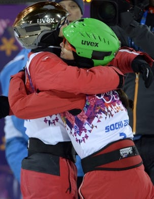 Feb 14, 2014; Krasnaya Polyana, RUSSIA; Mengtao Xu (CHN, left) hugs Nina Li (CHN, right) after in the ladies' freestyle skiing aerials finals during the Sochi 2014 Olympic Winter Games at Rosa Khutor Extreme Park. Xu won silver. Mandatory Credit: Jack Gruber-USA TODAY Sports