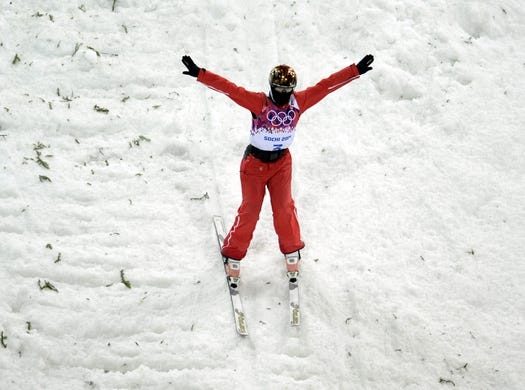 Feb 14, 2014; Krasnaya Polyana, RUSSIA; Mengtao Xu (CHN) competes in the ladies' freestyle skiing aerials finals during the Sochi 2014 Olympic Winter Games at Rosa Khutor Extreme Park. Mandatory Credit: Eric Bolte-USA TODAY Sports