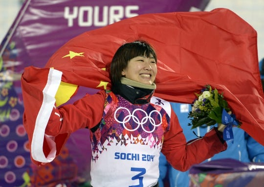 Feb 14, 2014; Krasnaya Polyana, RUSSIA; Mengtao Xu (CHN) reacts after winning silver in the ladies' freestyle skiing aerials finals during the Sochi 2014 Olympic Winter Games at Rosa Khutor Extreme Park. Mandatory Credit: Jack Gruber-USA TODAY Sports