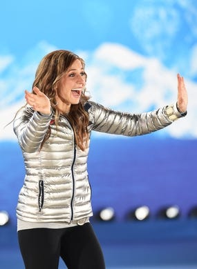 Feb 15, 2014; Sochi, RUSSIA; Noelle Pikus-Pace of the United States of America reacts while walking out to the podium during the medal ceremony for Women's Skeleton during the Sochi 2014 Olympic Winter Games at the Medals Plaza. Mandatory Credit: Robert Deutsch-USA TODAY Sports