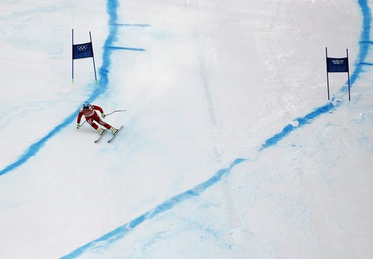 Feb 16, 2014; Krasnaya Polyana, RUSSIA; Beat Feuz (SUI) competes in men's alpine skiing super-G during the Sochi 2014 Olympic Winter Games at Rosa Khutor Alpine Center. Mandatory Credit: Rob Schumacher-USA TODAY Sports