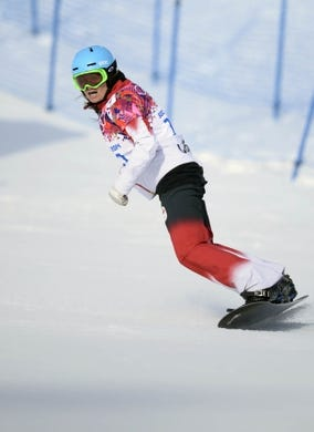 Feb 16, 2014; Krasnaya Polyana, RUSSIA; Maelle Ricker (CAN) after her first run in the ladies snowboard cross during the Sochi 2014 Olympic Winter Games at Rosa Khutor Extreme Park. Mandatory Credit: Jack Gruber-USA TODAY Sports