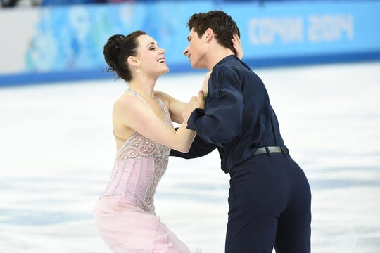 Feb 17, 2014; Sochi, RUSSIA; Scott Moir and Tessa Virtue (CAN) perform during the ice dance free dance program during the Sochi 2014 Olympic Winter Games at Iceberg Skating Palace. Mandatory Credit: Robert Deutsch-USA TODAY Sports