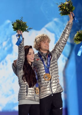 Feb 18, 2014; Sochi, RUSSIA; Meryl Davis (left) and Charlie White (right), of the United States of America, pose after receiving their gold medals during the medal ceremony for Figure Skating Ice Dance during the Sochi 2014 Olympic Winter Games at the Medals Plaza. Mandatory Credit: Jayne Kamin-Oncea-USA TODAY Sports