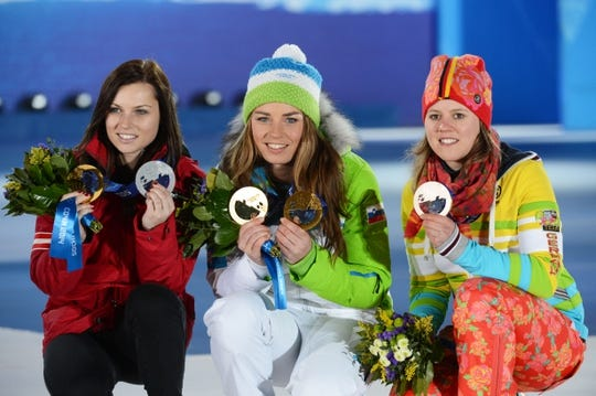 Feb 19, 2014; Sochi, RUSSIA; (Left to right( Viktoria Rebensburg of Germany, Anna Fenninger of Austria, and Tina Maze of Slovenia pose after receiving their medals during the medal ceremony for Alpine Skiing Ladies' Giant Slalom during the Sochi 2014 Olympic Winter Games at the Medals Plaza. Mandatory Credit: Jayne Kamin-Oncea-USA TODAY Sports