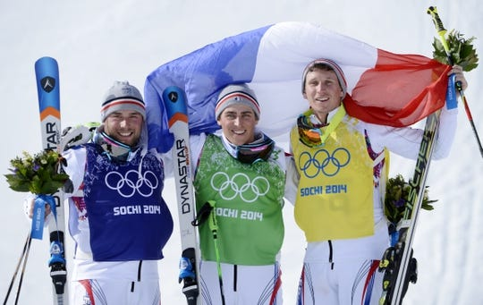Feb 20, 2014; Krasnaya Polyana, RUSSIA; French skiers Arnaud Bovolenta (blue) and Jean Frederic Chapuis (green) and Jonathan Midol (yellow) celebrate on the podium after the final for men's ski cross during the Sochi 2014 Olympic Winter Games at Rosa Khutor Extreme Park. Mandatory Credit: Jack Gruber-USA TODAY Sports