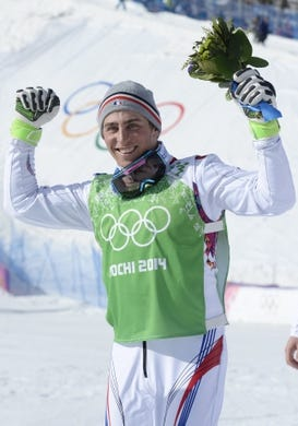 Feb 20, 2014; Krasnaya Polyana, RUSSIA;  Jean Frederic Chapuis (FRA) celebrates his victory after the flower ceremony for men's ski cross during the Sochi 2014 Olympic Winter Games at Rosa Khutor Extreme Park. Mandatory Credit: Jack Gruber-USA TODAY Sports