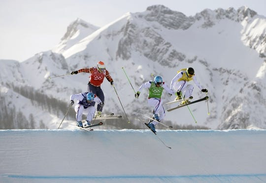 Feb 20, 2014; Krasnaya Polyana, RUSSIA; Jean Frederic Chapuis (FRA) (grn) leads Arnuad Bovolenta (FRA (blu), Jonathan Midol (FRA) (yel) and Brady Leman (CAN) (red)  in the men's freestyle ski cross final run during the Sochi 2014 Olympic Winter Games at Rosa Khutor Extreme Park. Mandatory Credit: Eric Bolte-USA TODAY Sports