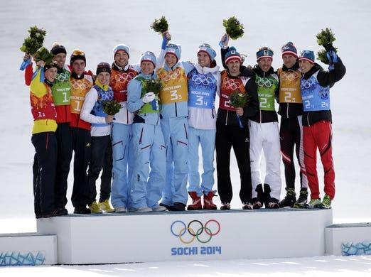 Feb 20, 2014; Krasnaya Polyana, RUSSIA; (From left to right) Eric Frenzel (GER), Bjoern Kircheisen (GER), Johannes Rydzek (GER), and Fabian Riessle (GER) win silver, Magnus Hovdal Moan (NOR), Haavard Klemetsen (NOR), Magnus Krog (NOR), and Joergen Graabak (NOR) win gold, and Lukas Klapfer (AUT), Christoph Bieler (AUT), Bernhard Gruber (AUT), and Mario Stecher (AUT) win bronze in nordic combined team gundersen LH / 4x5 km during the Sochi 2014 Olympic Winter Games at RusSki Gorki Ski Jumping Center. Mandatory Credit: Andrew P. Scott-USA TODAY Sports
