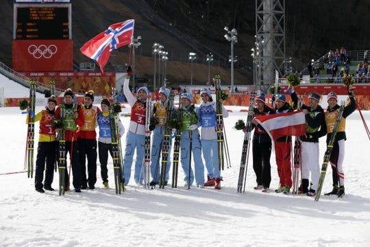 Feb 20, 2014; Krasnaya Polyana, RUSSIA; (From left to right) Eric Frenzel (GER), Bjoern Kircheisen (GER), Johannes Rydzek (GER), and Fabian Riessle (GER) win silver, Magnus Hovdal Moan (NOR), Magnus Krog (NOR), Haavard Klemetsen (NOR) and Joergen Graabak (NOR) win gold, and Lukas Klapfer (AUT), Mario Stecher (AUT), Christoph Bieler (AUT), and Bernhard Gruber (AUT) win bronze in nordic combined team gundersen LH / 4x5 km during the Sochi 2014 Olympic Winter Games at RusSki Gorki Ski Jumping Center. Mandatory Credit: Andrew P. Scott-USA TODAY Sports