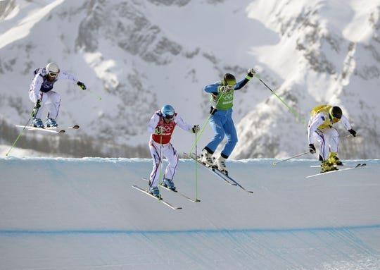 Feb 20, 2014; Krasnaya Polyana, RUSSIA; Jean Frederic Chapuis (FRA) (red) leads the field in the men's freestyle ski cross quarterfinal run 2 during the Sochi 2014 Olympic Winter Games at Rosa Khutor Extreme Park. Mandatory Credit: Eric Bolte-USA TODAY Sports