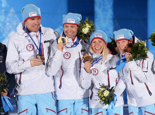 Feb 20, 2014; Sochi, RUSSIA; (Left to right) Emil Hegle Svendsen, Ole Einar Bjoerndalen, and Tiril Eckhoff, Tora Berger, all of Norway pose after receiving their gold medals during the medal ceremony for Biathlon Mixed Relays during the Sochi 2014 Olympic Winter Games at Live Site/Medals Plaza. Mandatory Credit: Jayne Kamin-Oncea-USA TODAY Sports