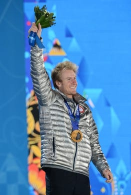 Feb 20, 2014; Sochi, RUSSIA; Ted Ligety of the USA reacts to the crowd after receiving his gold medal during the medal ceremony for Alpine Skiing Men's Giant Slalom during the Sochi 2014 Olympic Winter Games at the Medals Plaza. Mandatory Credit: Jayne Kamin-Oncea-USA TODAY Sports