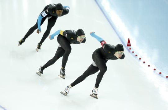 Feb 21, 2014; Sochi, RUSSIA; (Left to right) Shani Davis, Jonathan Kuck, and Brian Hansen, all of the USA skate in the Speed Skating men's team pursuit quarterfinals during the Sochi 2014 Olympic Winter Games at Adler Arena Skating Center. Mandatory Credit: Jeff Swinger-USA TODAY Sports