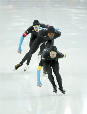 Feb 21, 2014; Sochi, RUSSIA; (Front to back) Jonathan Kuck, Shani Davis, and Brian Hansen, all of the USA skate in the Speed Skating men's team pursuit quarterfinals during the Sochi 2014 Olympic Winter Games at Adler Arena Skating Center. Mandatory Credit: Jeff Swinger-USA TODAY Sports