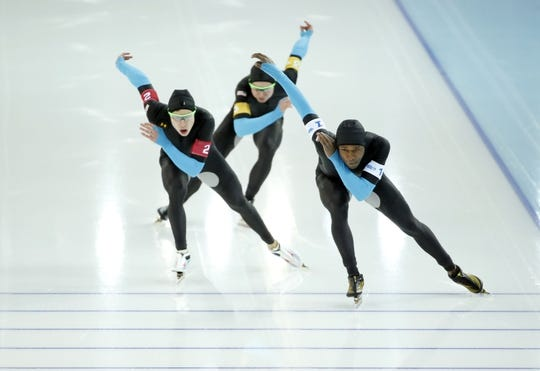 Feb 21, 2014; Sochi, RUSSIA; (Left to right) Brian Hansen, Jonathan Kuck, and Shani Davis all of the USA, skate in the Speed Skating men's team pursuit quarterfinals during the Sochi 2014 Olympic Winter Games at Adler Arena Skating Center. Mandatory Credit: Jeff Swinger-USA TODAY Sports