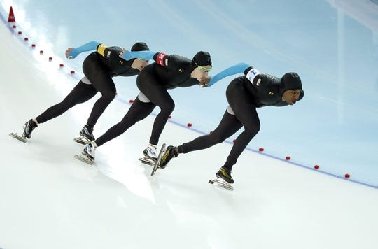 Feb 21, 2014; Sochi, RUSSIA; (Left to right) Jonathan Kuck, Brian Hansen, and Shani Davis all of the USA, skate in the Speed Skating men's team pursuit quarterfinals during the Sochi 2014 Olympic Winter Games at Adler Arena Skating Center. Mandatory Credit: Jeff Swinger-USA TODAY Sportszzzzzzzz
