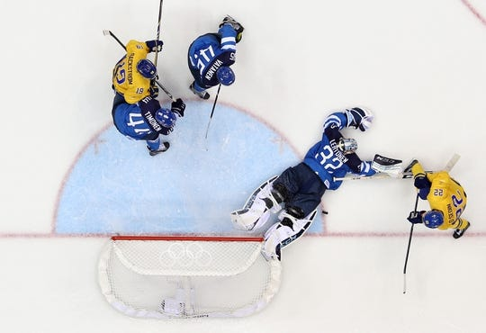 Feb 21, 2014; Sochi, RUSSIA; Finland goalie Kari Lehtonen (32) makes a save against Sweden forward Daniel Sedin (22)  in the men's ice hockey semifinals during the Sochi 2014 Olympic Winter Games at Bolshoy Ice Dome. Mandatory Credit: Winslow Townson-USA TODAY Sports
