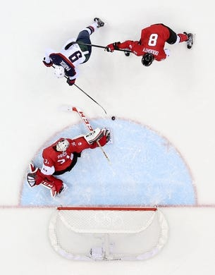 Feb 21, 2014; Sochi, RUSSIA; Canada goalie Carey Price (31) and defenseman Drew Doughty (8) defend the net against USA forward Zach Parise (9) in the men's ice hockey semifinals during the Sochi 2014 Olympic Winter Games at Bolshoy Ice Dome. Mandatory Credit: Winslow Townson-USA TODAY Sports