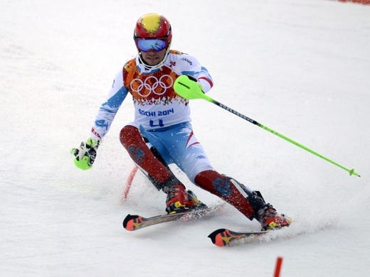 Feb 22, 2014; Krasnaya Polyana, RUSSIA; Marcel Hirscher (AUT) competes in the first run of men's alpine skiing slalom during the Sochi 2014 Olympic Winter Games at Rosa Khutor Alpine Center. Mandatory Credit: Eric Bolte-USA TODAY Sports