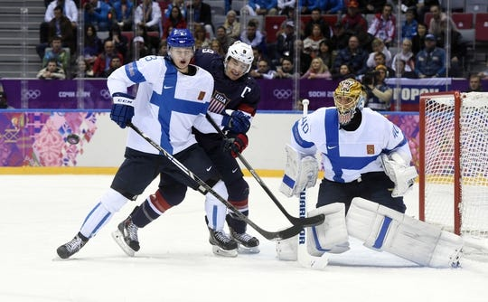 Feb 22, 2014; Sochi, RUSSIA; USA forward Zach Parise (9) tries to deflect the puck against Finland goalie Tuukka Rask (40) and defenseman Olli Maata (3) in the men's ice hockey bronze medal game during the Sochi 2014 Olympic Winter Games at Bolshoy Ice Dome. Mandatory Credit: Scott Rovak-USA TODAY Sports