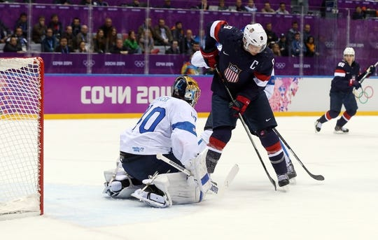 Feb 22, 2014; Sochi, RUSSIA; Finland goalie Tuukka Rask (40) makes a save against USA forward Zach Parise (9) in the men's ice hockey bronze medal game during the Sochi 2014 Olympic Winter Games at Bolshoy Ice Dome. Mandatory Credit: Winslow Townson-USA TODAY Sports