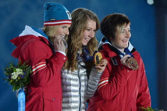 Feb 22, 2014; Sochi, RUSSIA; Marlies Schild (AUT) (left), Mikaela Shiffrin (USA) (center), and Kathrin Zettel (AUT) (right) celebrate winning the silver, gold, and bronze medals, respectively, in alpine skiing ladies  slalom during the Sochi 2014 Olympic Winter Games at the Medals Plaza. Mandatory Credit: Jayne Kamin-Oncea-USA TODAY Sports