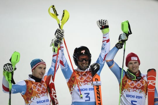Feb 22, 2014; Krasnaya Polyana, RUSSIA; Marcel Hirscher (AUT, left), Mario Matt (AUT, center), and Henrik Kristoffersen (NOR, right) competes in the second run of men's alpine skiing slalom during the Sochi 2014 Olympic Winter Games at Rosa Khutor Alpine Center. Mandatory Credit: Jack Gruber-USA TODAY Sports