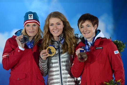 Feb 22, 2014; Sochi, RUSSIA; Marlies Schild (AUT) (left), Mikaela Shiffrin (USA) (center), and Kathrin Zettel (AUT) (right) celebrate winning the silver, gold, and bronze medals, respectively, during the Sochi 2014 Olympic Winter Games at the Medals Plaza. Mandatory Credit: Jayne Kamin-Oncea-USA TODAY Sports
