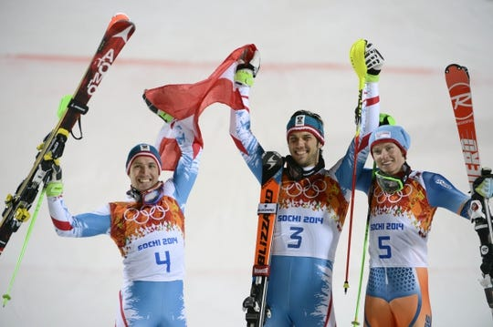 Feb 22, 2014; Krasnaya Polyana, RUSSIA; Mario Matt (AUT, 3) wins gold, Marcel Hirscher (AUT, 4) wins silver, and Henrik Kristoffersen (NOR, 5) wins bronze in men's alpine skiing slalom during the Sochi 2014 Olympic Winter Games at Rosa Khutor Alpine Center. Mandatory Credit: Jack Gruber-USA TODAY Sports
